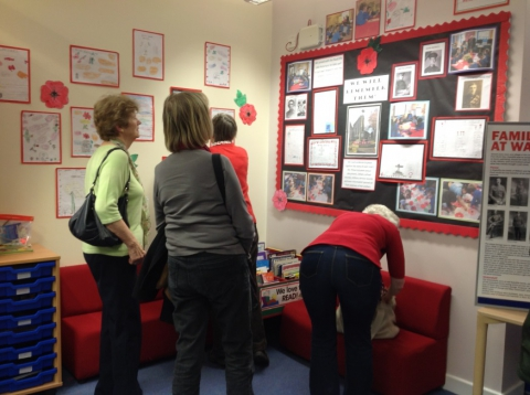 Members of Radcliffe U3A WWI team admire pupils' work